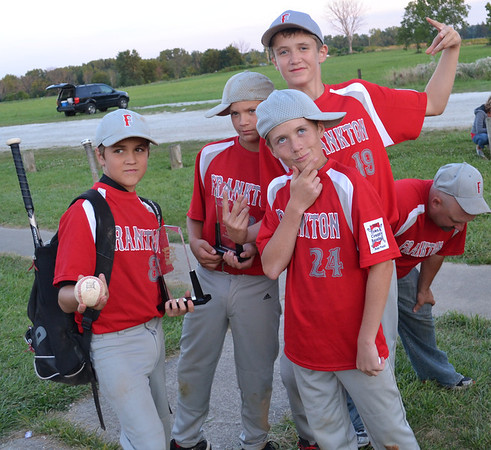 After capturing the state championship, Colt Litsey, Jon Hatzell, Andrew Hartley, and Rylan Detling are getting silly while coach Chris Hatzell catches his breath.<br /> <br /> Photographer's Name: Terry Ward<br /> Photographer's City and State: Frankton, Ind.