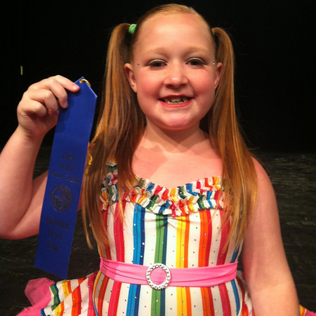 Kayla Porter, from Yorktown, won first place in the youth talent solo dance division at the Indiana State Fair. Kayla had won first place in the youth tap solo division at the Madison county 4-H Fair, which then advanced her to the Indiana State Fair talent show. Kayla is the daughter of Matt Porter and Kira Smith and the granddaughter of Marina Fite, Tammy Ward-Bair, Mike and Judy Porter, Eddie Smith and Steve Fite. <br /> <br /> Photographer's Name: Marina Fite<br /> Photographer's City and State: Anderson, Ind.