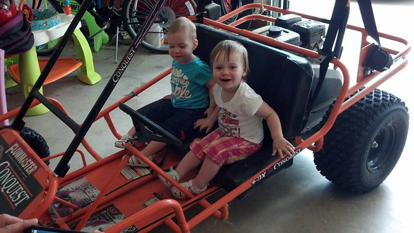 Twin sisters Sophia and McKenzie Bell in the family go-cart.<br /> <br /> Photographer's Name: Carole Bell<br /> Photographer's City and State: Anderson, Ind.