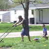 My son, Dylan Brown, and his little guy, my grandson, Adam, mowing the lawn together! Priceless!<br /> <br /> Photographer's Name: Colleen Sanders-Brown<br /> Photographer's City and State: Anderson, Ind.