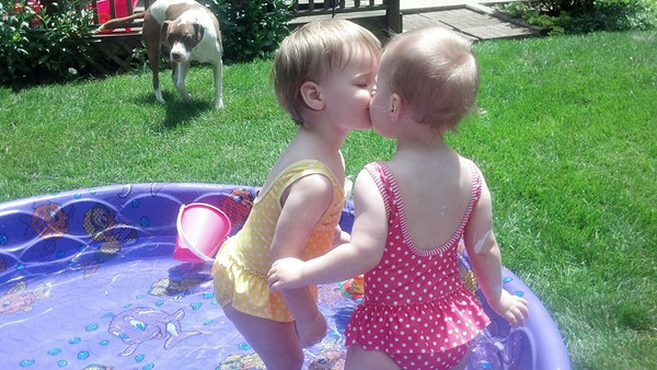 Twin sisters McKenzie and Sophie Bell loving each other.<br /> <br /> Photographer's Name: Carole Bell<br /> Photographer's City and State: Anderson, Ind.