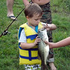 Four-year-old catches a three-and-a-half pounder -- grandson Ely Coxe.<br /> <br /> Photographer's Name: J.R. Rosencrans<br /> Photographer's City and State: Alexandria, Ind.