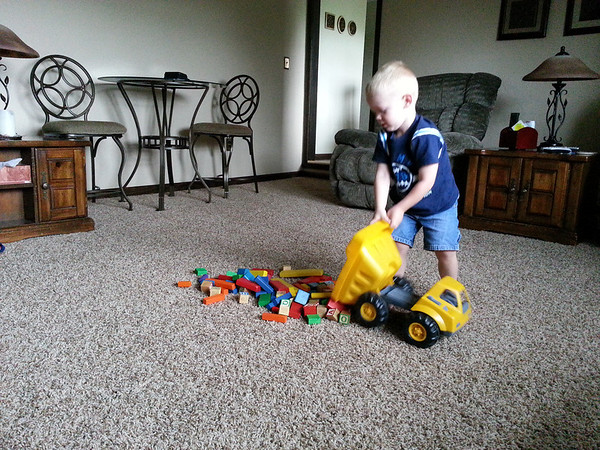 After seeing the levee project in Anderson, Carter, my almost 3-year old grandson, dumped 'piles of dirt' as he called it.<br /> <br /> Photographer's Name: Mike McDonald<br /> Photographer's City and State: Anderson, Ind.