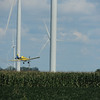 A crop duster spraying corn north of Elwood at the Wildcat Wind Farm on County Road 1500 North.<br /> <br /> Photographer's Name: Steve Remington<br /> Photographer's City and State: Noblesville, Ind.