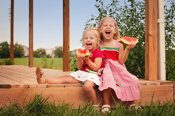 My granddaughters Kambria and Evie Fox enjoying their watermelon.<br /> <br /> Photographer's Name: Terry Lynn Ayers<br /> Photographer's City and State: Anderson, Ind.