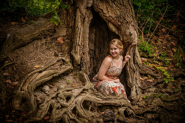 My daughter Cassandra Ayers in a tree trunk at Shadyside Park.<br /> <br /> Photographer's Name: Terry Lynn Ayers<br /> Photographer's City and State: Anderson, Ind.