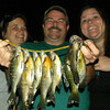 My husband Ed Drews and our daughters showing off their catch.<br /> <br /> Photographer's Name: Rita Drews<br /> Photographer's City and State: Anderson, Ind.