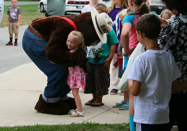 An excited little girl receives a big hug from Smokey Bear at Mounds State Park at his birthday party last Saturday.<br /> <br /> Photographer's Name: Jerry Byard<br /> Photographer's City and State: Anderson, Ind.