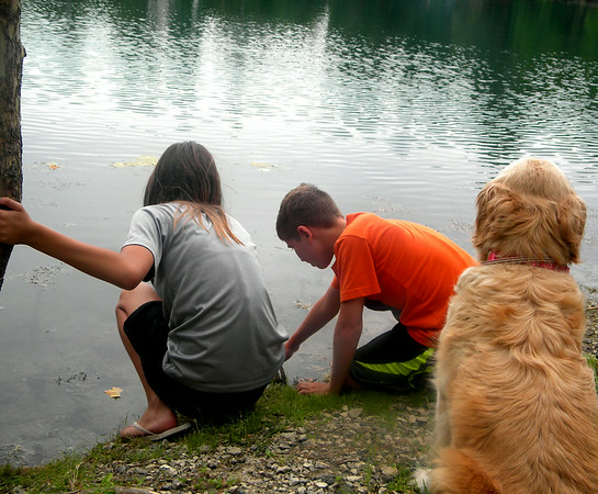 Summer fun: my grandaughter Brooke Ancil with her friends trying to catch tadpoles.<br /> <br /> Photographer's Name: Rita Drews<br /> Photographer's City and State: Anderson, Ind.