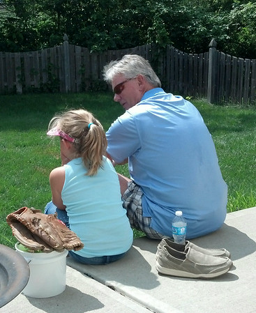 My fiance Tom Barnett talking softball with his 7-year-old granddaughter Addison Sumerall.<br /> <br /> Photographer's Name: Marlo Smith<br /> Photographer's City and State: Anderson, Ind.