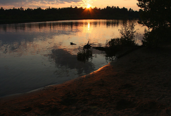 A beautiful sunset at Tahquamenon Falls Rivermouth Camgrounds was a great way to end the day.<br /> <br /> Photographer's Name: Jerry Byard<br /> Photographer's City and State: Anderson, Ind.