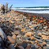 Stumps, stones and crashing waves enhance the Lake Superior shoreline in Upper Michigan.<br /> <br /> Photographer's Name: Jerry Byard<br /> Photographer's City and State: Anderson, Ind.
