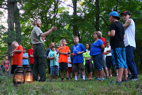 A scout troop from Rockford, Mich., joined Aaron Douglas and others on an evening hike to Circle Mound at Mounds Park on Saturday.<br /> <br /> Photographer's Name: Jerry Byard<br /> Photographer's City and State: Anderson, Ind.
