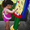 This photo was taken a few years ago, my granddaughter painting on a summer day.<br /> <br /> Photographer's Name: Debra Howell<br /> Photographer's City and State: Pendleton, Ind.