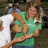 Two ladies, Rose and Rachel, wrestle with a Smore at Mounds Park on National Smores Day.<br /> <br /> Photographer's Name: Jerry Byard<br /> Photographer's City and State: Anderson, Ind.