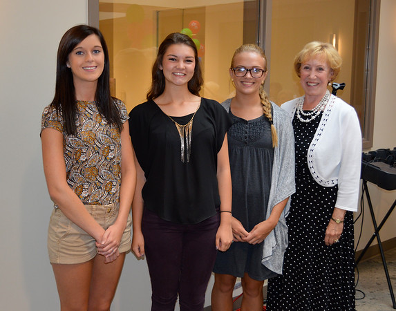 Community Hospital Anderson Auxiliary Scholarship winners, from left: Stacy Hayden, Colleen Matthew, Mandie Flora, and scholarship chairperson Nancy Likens.<br /> <br /> Photographer's Name: Susan Heiden<br /> Photographer's City and State: Alexandria, Ind.