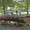 A new dugout canoe being constructed in Mounds Park by the Friends of The Mounds members in the photo.<br /> <br /> Photographer's Name: Pete Domery<br /> Photographer's City and State: Anderson, Ind.