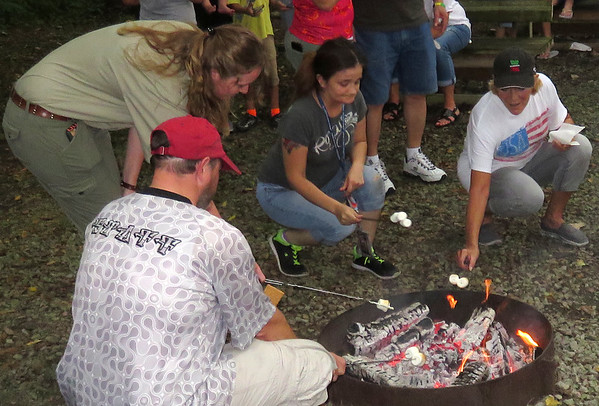 A group of folks at Mounds Park are making smores during National Smores Day.<br /> <br /> Photographer's Name: Jerry Byard<br /> Photographer's City and State: Anderson, Ind.