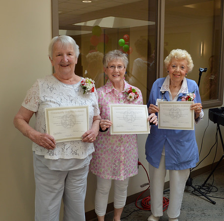 Community Hospital volunteers serving more than 10,000 hours are honored at the annual Strawberry Festival: Donna Jones, Janice Archer, and Patty Waddell.<br /> <br /> Photographer's Name: Susan Heiden<br /> Photographer's City and State: Alexandria, Ind.