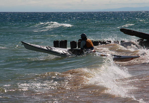 A kayaker attempts to launch in Lake Superior at Whitefish Point, Michigan.<br /> <br /> Photographer's Name: Jerry Byard<br /> Photographer's City and State: Anderson, Ind.