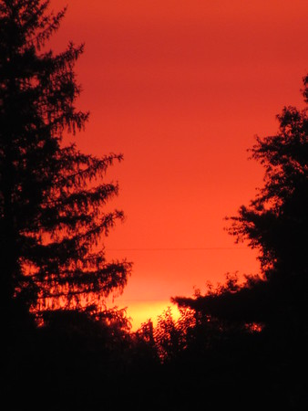 July sunset.<br /> <br /> Photographer's Name: Harry Van Noy<br /> Photographer's City and State: Lafayette Township, Ind.
