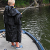 A little rain, no problem. Eli Coxe fishing at Shadyside Lake.<br /> <br /> Photographer's Name: J. R. Rosencrans<br /> Photographer's City and State: Alexandria, Ind.