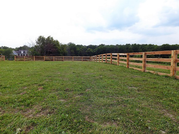 New fence for a new horse arena at Moon Rise Farms, Richland Township.<br /> <br /> Photographer's Name: J.R. Rosencrans<br /> Photographer's City and State: Alexandria, Ind.