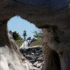 Whitefish Point Lighthouse shows through the hole in the driftwood.<br /> <br /> Photographer's Name: Jerry Byard<br /> Photographer's City and State: Anderson, Ind.