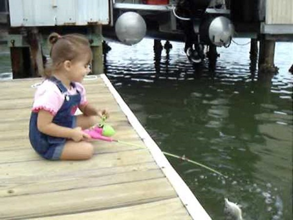 Alise, 4, catching her first fish.<br /> <br /> Photographer's Name: Nicole Winkler<br /> Photographer's City and State: Anderson, Ind.