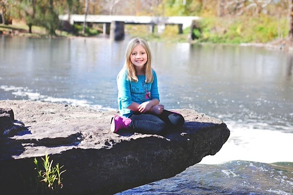 My granddaughter Lilly McIntyre enjoying a photo opportunity at Falls Park on one of the last warmer days.<br /> <br /> Photographer's Name: Tina Snyder<br /> Photographer's City and State: Anderson, Ind.