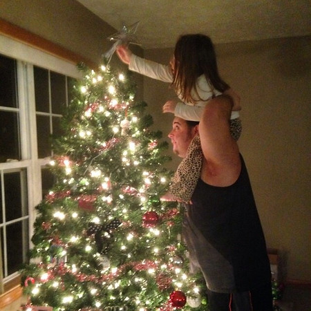 This is Casey Mattingly and his 3-year-old daughter, Ashton Mattingly, putting the finishing touch on their Christmas tree.<br /> <br /> Photographer's Name: Carrie Long<br /> Photographer's City and State: Alexandria, Ind.