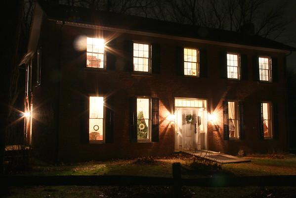 The historic Bronnenberg house at Mounds State Park held a Christmas celebration open house on Saturday evening.<br /> <br /> Photographer's Name: Jerry Byard<br /> Photographer's City and State: Anderson, Ind.
