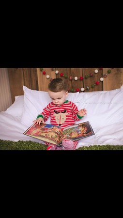 Easton James Pershing. He loves books! Our grandson loves to read!<br /> <br /> Photographer's Name: Barbara Pershing<br /> Photographer's City and State: Anderson, Ind.