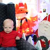 Serenity Milan sits with some of her Christmas friends.<br /> <br /> Photographer's Name: Brian Fox<br /> Photographer's City and State: Anderson, Ind.