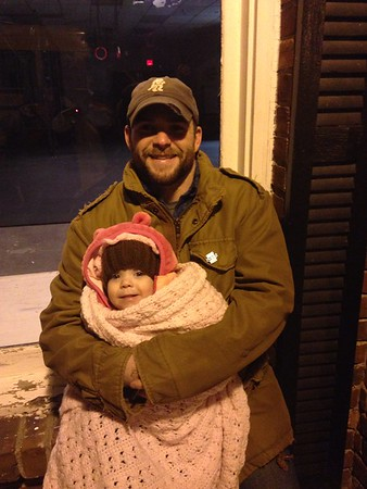 Andy Sovern and his one-year-old daughter Aubrey are bundled up for the Alexandria Christmas Parade.<br /> <br /> Photographer's Name: Carrie Long<br /> Photographer's City and State: Alexandria, Ind.