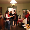 The Mounds naturalists are singing with visitors at the Bronnenberg Christmas open house.<br /> <br /> Photographer's Name: Jerry Byard<br /> Photographer's City and State: Anderson, Ind.