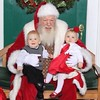 Twin grandchildren, Sebastian and Scarlett Young (11 1/2 months old) on their first visit with Santa.<br /> <br /> Photographer's Name: Shari Lawyer<br /> Photographer's City and State: Anderson, Ind.