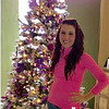 """Nicole Winkler of Anderson stands beside her Christmas tree that she made using all the colors of the American Cancer Society and March Of Dimes, the two organizations she has helped in 2015 through her songs """"You're Someone Special To Me""""  and a current song, """"Mrs. Martha Claus,"""" she co-wrote with Abby Wilson Hanna Walker and Sean Ferree who came up with the song title.<br /> <br /> Photographer's Name: Nicole Winkler<br /> Photographer's City and State: Anderson, Ind."""
