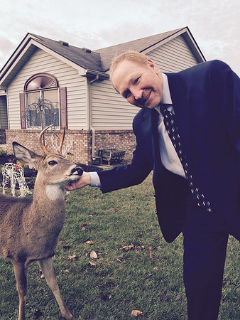 Our friend, Michael Jayne, met this guy Sunday at his house in Pendleton!  He said the deer wasn't afraid of them at all and there are other pictures circulating showing the same deer at the park!  Rudolph must be vacationing in Pendleton this year! ;-)<br /> <br /> Photographer's Name: Colleen Sanders Broyles<br /> Photographer's City and State: Anderson, Ind.