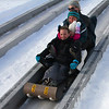 These folks were the first ones to take the toboggan run at Pokagon State Park.<br /> <br /> Photographer's Name: Jerry Byard<br /> Photographer's City and State: Anderson, Ind.