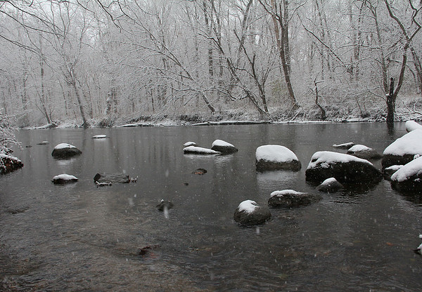 Snow covered stones in White River at Mounds Park.<br /> <br /> Photographer's Name: Jerry Byard<br /> Photographer's City and State: Anderson, Ind.