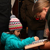 Little girl and Kelley with a musical instrument at the Christmas Open House at Mounds Park.<br /> <br /> Photographer's Name: Jerry Byard<br /> Photographer's City and State: Anderson, Ind.