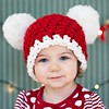 My 3, year old niece Alisa, helping me decorate the house in her new Christmas hat.<br /> <br /> Photographer's Name: Nicole Winkler<br /> Photographer's City and State: Anderson, Ind.