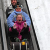 At Pokagon State Park these folks enjoy a wild ride down the toboggan run.<br /> <br /> Photographer's Name: Jerry Byard<br /> Photographer's City and State: Anderson, Ind.