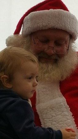Braxten Fix enjoying sitting on Santa's lap during the Alexandria Toy Drive.<br /> <br /> Photographer's Name: Terri Brenner<br /> Photographer's City and State: Alexandria, Ind.
