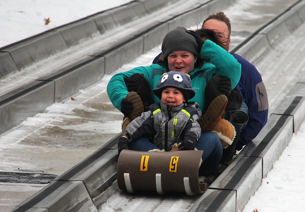 A cute little person enjoying the ride with the family at Pokagon State Park.<br /> <br /> Photographer's Name: Jerry Byard<br /> Photographer's City and State: Anderson, Ind.