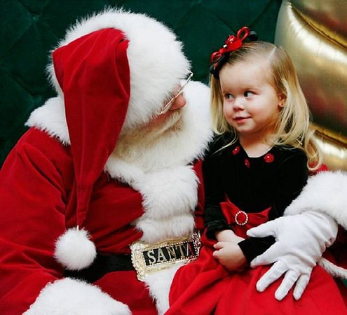 My little sister Jessie, 4, sitting on Santa's lap at the Circle Of Lights in Indianapolis.<br /> <br /> Photographer's Name: Nicole Winkler<br /> Photographer's City and State: Anderson, Ind.
