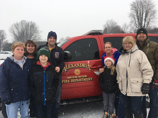 Members of the Alexandria Elks deliver Christmas baskets to needy families on Christmas Eve.<br /> <br /> Photographer's Name: Carrie Long<br /> Photographer's City and State: Alexandria, Ind.