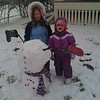 Abby 7, and baby Alise, 2, stand beside their upside down snowman they made with their older sister Hanna, 8 (not pictured).<br /> <br /> Photographer's Name: Nicole Walker<br /> Photographer's City and State: Anderson, Ind.