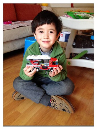 My grandson Eric in China with his self-assembled fire truck.<br /> <br /> Photographer's Name: Harry Kirchenbauer<br /> Photographer's City and State: Anderson, Ind.